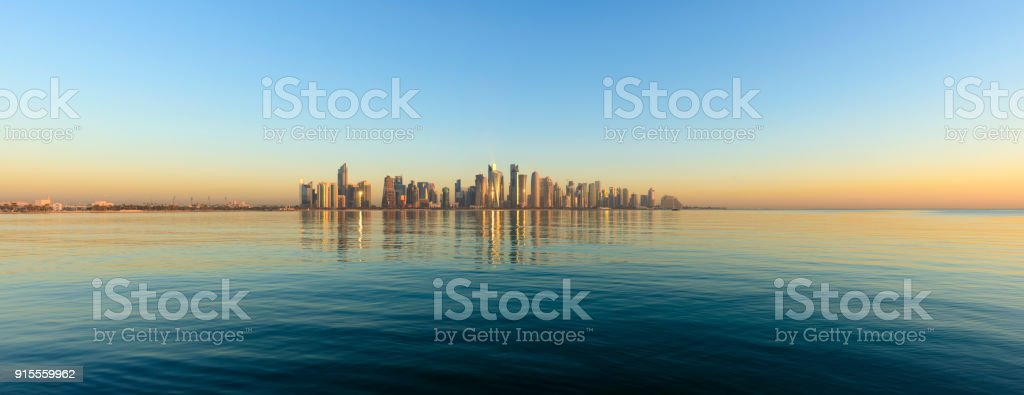 Panoramic View of the Downtown Doha City Skyline at sunset, Qatar stock photo