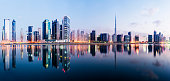 Panoramic view of the Dubai downtown and business park district at twilight, UAE.