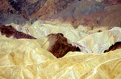 Colorful hills near Zabriskie Point look like mountains of cream and chocolate ice cream. The unusual colors are due to the presence of mineral salts.