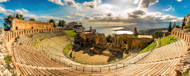 Panoramic view of The Greek theater in Taormina, Sicily The Ancient theater in Sicily , is an impressive monument, overlooking the Mediterranean Sea and Mount Etna. It is used as a stage for numerous artistic performances and attracts thousands of tourists every year. sicily stock pictures, royalty-free photos & images