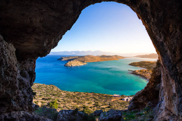 Panoramic view of the gulf of Mirambello with Spinalonga island. View from the mountain through a cave, Crete, Greece. stock photo