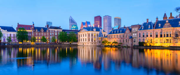 Panoramic View of The Hague Downtown City Skyline and Parliament Buildings at Twilight, Netherlands stock photo