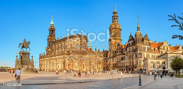 DRESDEN, GERMANY - 20 MAY 2018: Panoramic view of the Holy Trinity Cathedral or Hofkirche, Dresden Castle with Hausmannsturm Tower at sunset