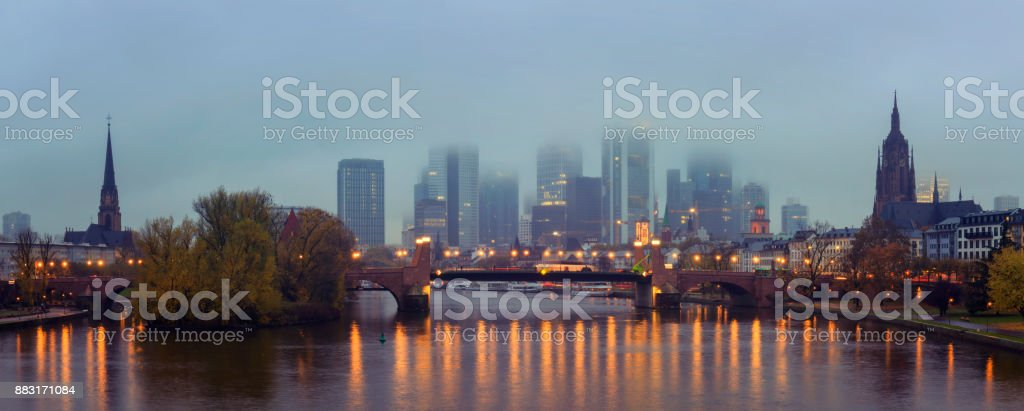 Panoramic view of the illuminated Frankfurt am Main skyline with Alte Brucke and the Dom at dusk stock photo