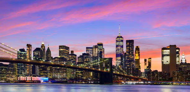Panoramic View of the Manhattan City Skyline and Brooklyn Bridge at Twilight, New York, USA stock photo