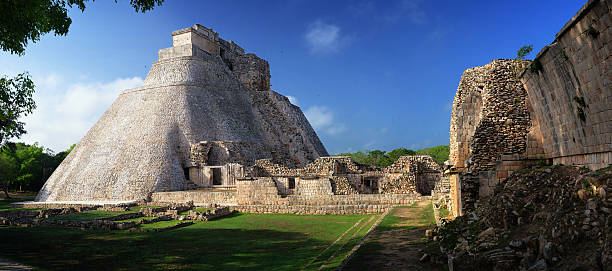 panoramic view of the mayan pyramids in uxmal, yucatan, mexico. - uxmal stock photos and pictures