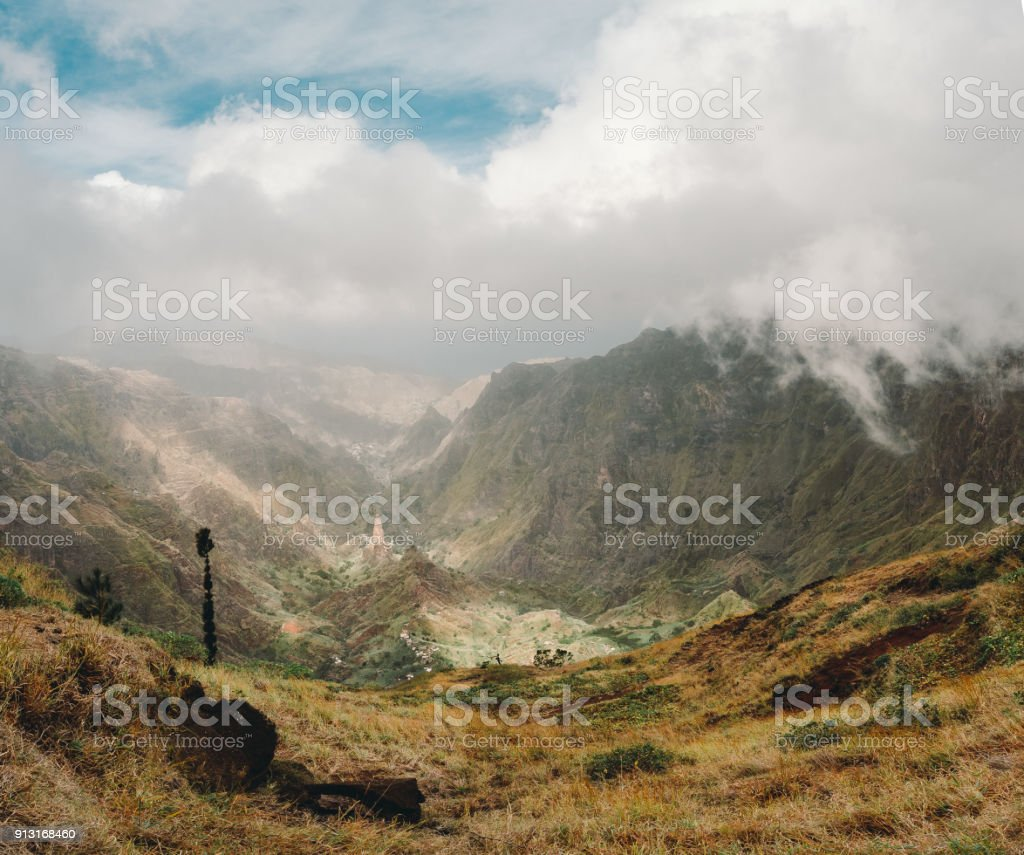Panoramic view of the mountain valley of Santa Antao island in Cape Verde. Big clouds moving over the mountains and gethering over the lush green Xo-Xo valley stock photo