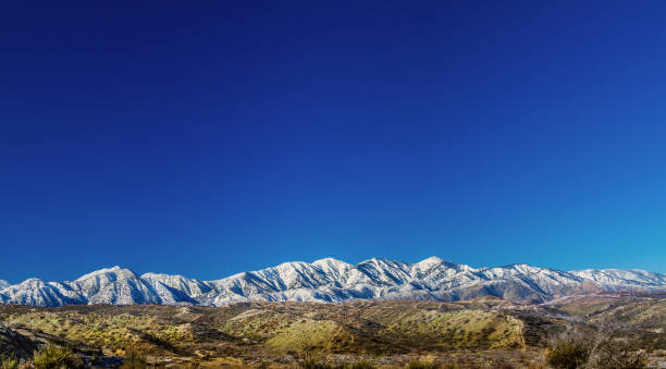 Panoramic view of the north side of the San Gabriel Mounatins in Southerm California, taken from the Mojave Desert. Panoramic view of the north side of the San Gabriel Mounatins in Southerm California, taken from the Mojave Desert. san bernardino california stock pictures, royalty-free photos & images