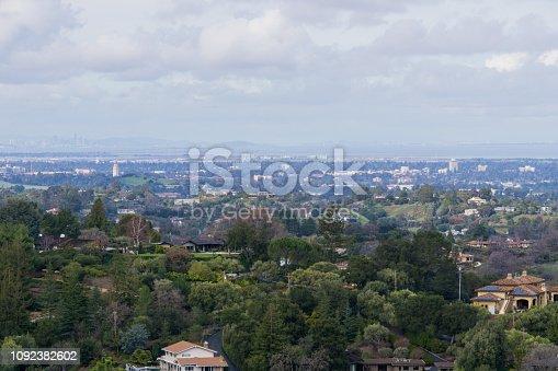 Panoramic view of the Peninsula on a cloudy day; view towards Los Altos, Palo Alto, Menlo Park, Silicon Valley and Dumbarton Bridge and San Francisco in the background, San Francisco bay, California