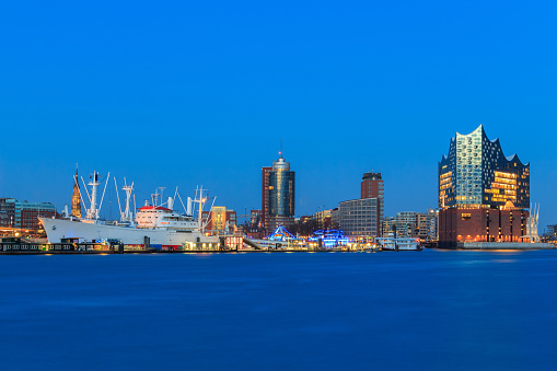 Panoramic view of the port of Hamburg during the blue hour in the early evening