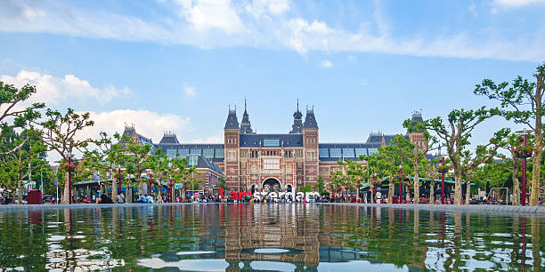 Panoramic view of the Rijksmuseum in Amsterdam Amsterdam, The Netherlands - June 26, 2014: Panoramic view of the Rijksmuseum with the I Amsterdam sign in front in Amsterdam, The Netherlands museumplein stock pictures, royalty-free photos & images