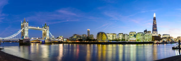 Panoramic View of the River Thames with Tower Bridge and the London City Skyline stock photo