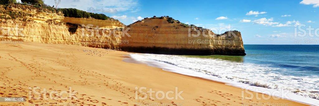 Panoramic view of the rock formations. Praia de Marinha, Caramujeira, Lagoa, Algarve, Portugal. - Стоковые фото Алгарви роялти-фри