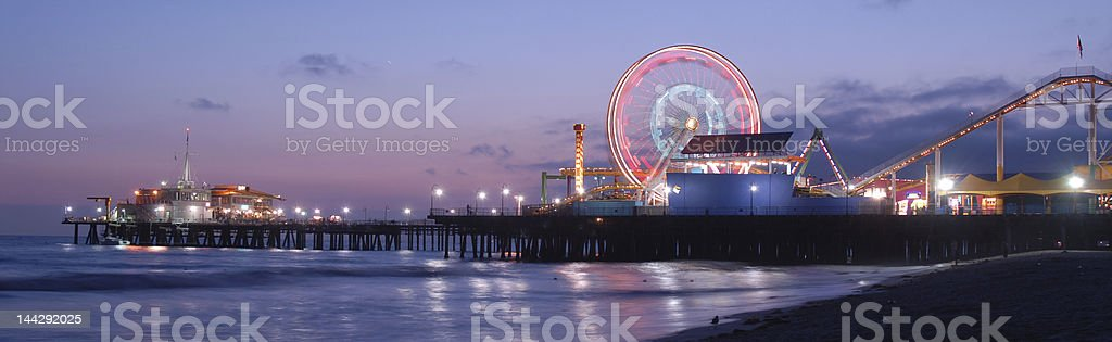 Panoramic view of the Santa Monica Pier at sunset stock photo