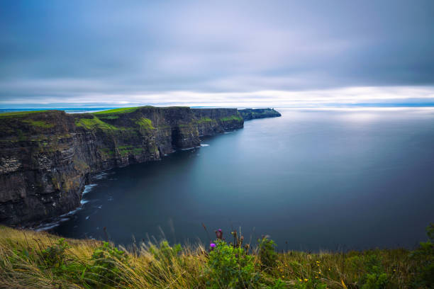 Panoramic view of the scenic Cliffs of Moher in Ireland stock photo
