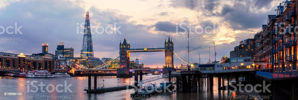 Panoramic view of The Shard and Tower Bridge at dusk stock photo