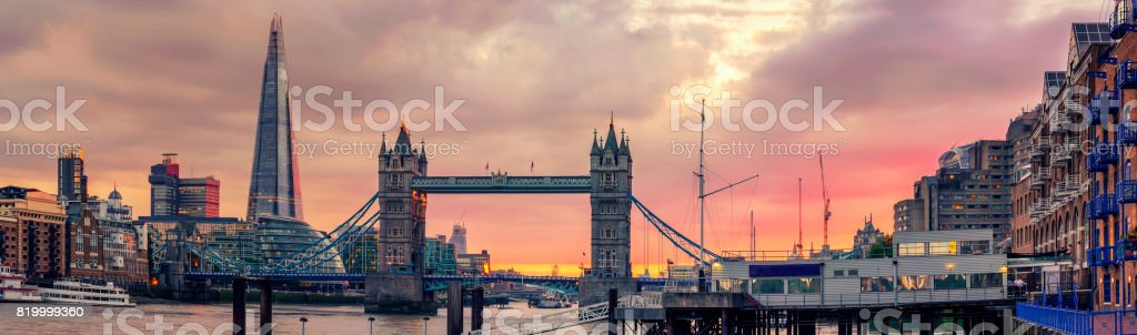 Panoramic view of The Shard and Tower Bridge at in a majestic red sunset stock photo