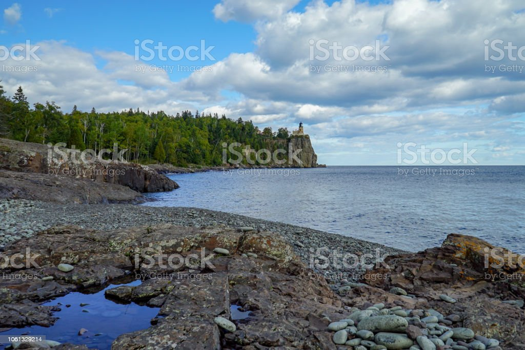 Panoramic view of the Split Rock Lighthouse from a nearby rocky beach stock photo