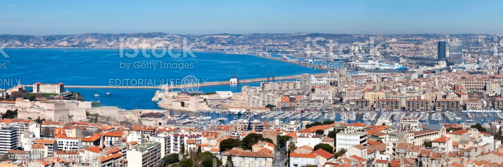 Panoramic view of the Vieux Port of Marseille Marseille, France - March 23 2019: Panoramic view of the Vieux Port with the City Hall, the Palais Pharo, the Fort Saint-Nicolas and many other landmarks. Aerial View Stock Photo