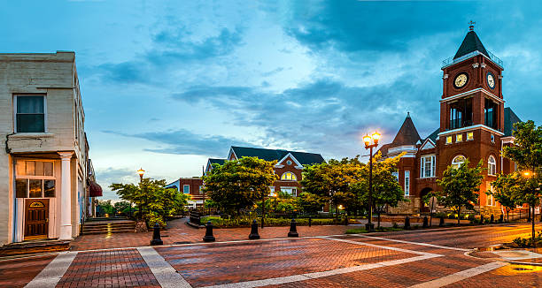 Panoramic view of town square in Dallas, Georgia Panoramic view of town square in Dallas, Georgia, after sunset town square stock pictures, royalty-free photos & images