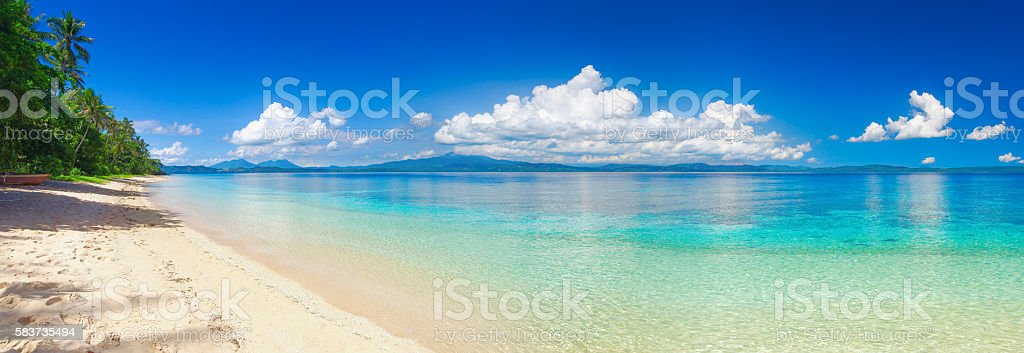 Panoramic view of tropical beach on background the islands stock photo