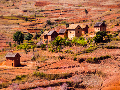 istock Panoramic view of typical bara village in the countryside of the National Route 7 near Antsirabe, Madagascar 1212584371