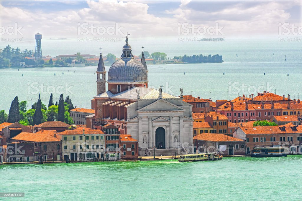 Panoramic view of Venice from the Campanile tower Island of Giudecca and Redentore Church ( Chiesa del Santissimo Redentore). stock photo