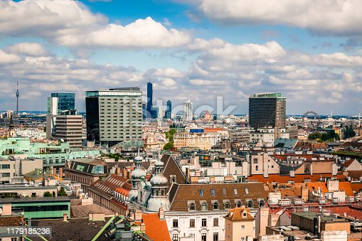 Panoramic view of old town and modern skyscrapers in Vienna, Austria. Tile roofs of historical buildings and top of contemporary architecture.