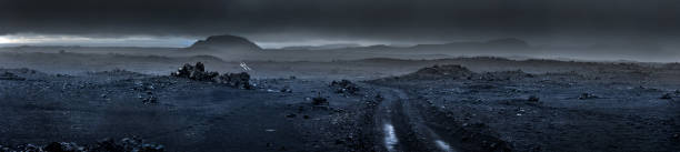 Panoramic view of volcanic landscape at Iceland. Panoramic view of dirt road at remains of a volcano at Iceland. volcanic landscape stock pictures, royalty-free photos & images