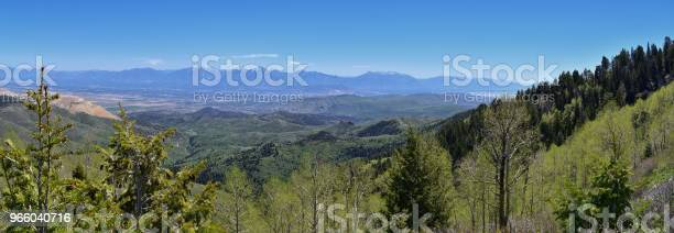 Panoramic View Of Wasatch Front Rocky Mountains From The Oquirrh Mountains By Kennecott Rio Tinto Copper Mine Utah Lake And Great Salt Lake Valley In Early Spring With Melting Snow And Cloudscape Utah Usa Stock Photo - Download Image Now