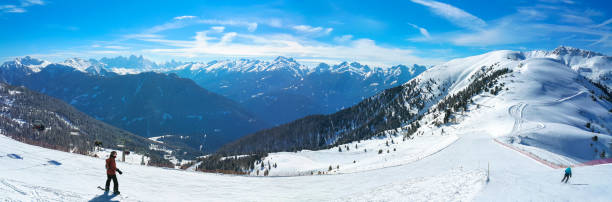 panoramic view of well prepared ski track in alpine ski resort. - latemar foto e immagini stock