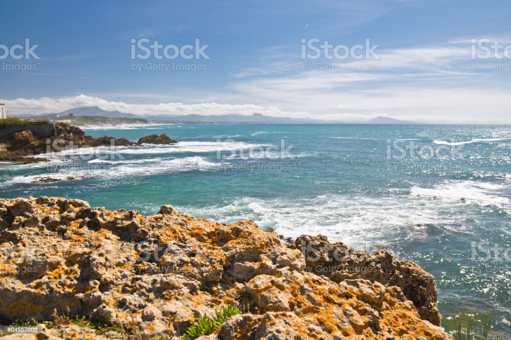 panoramic view on beautiful atlantic coastline with turquoise ocean and mountains in basque country, biarritz, france stock photo