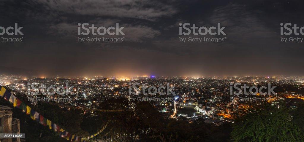 Panoramic view on city of Kathmandu in night-time lighting. stock photo