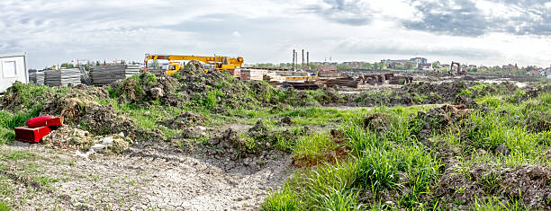 Panoramic view on landscape transform into urban area Panorama is showing a landscape transform into urban area with machinery, people are working. View on construction site. time zone stock pictures, royalty-free photos & images