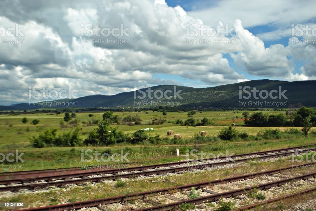 Panoramic view on the nature from the train rails royalty-free stock photo