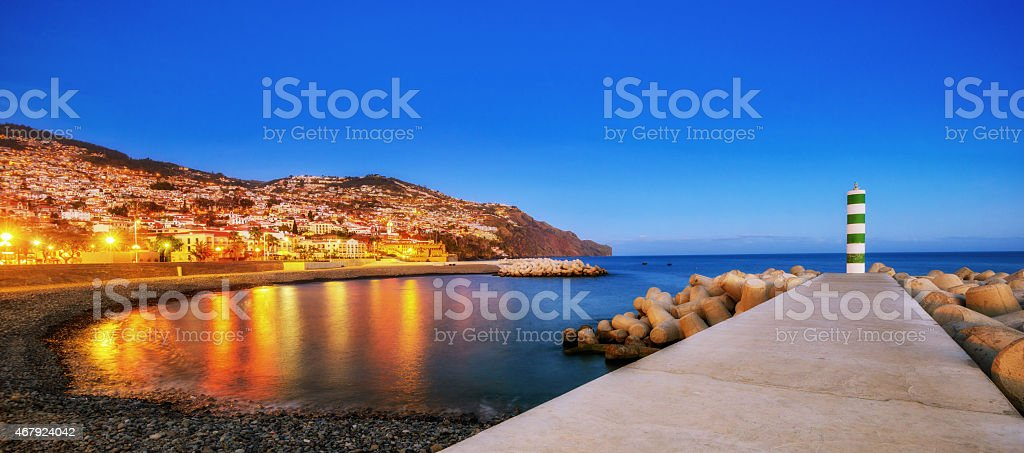 Panoramic view over Funchal beach and downtown at night stock photo