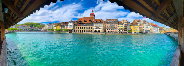 Panoramic View over Reuss River and Chapel Bridge in City of Lucerne stock photo