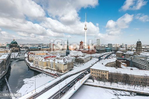 istock panoramic view over snowy Berlin cityscape with Cathedral TV-tower and River in winter 1301733825