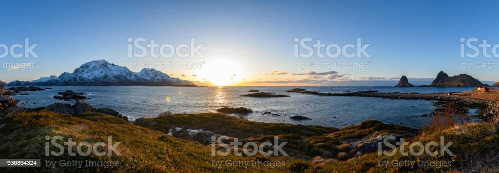 Panoramic view over the Norwegian Sea at Vesteralen islands during a winter sunset stock photo
