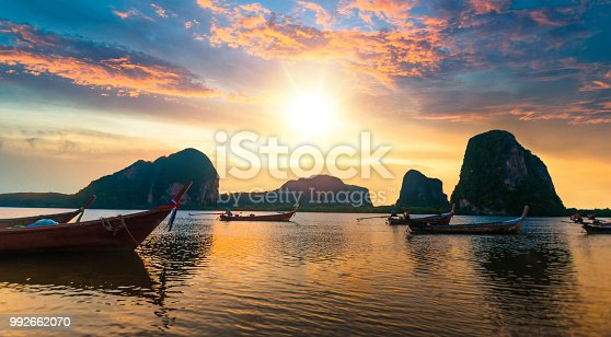 Panoramic view shot tropical beach sea with long tail boat in south thailand