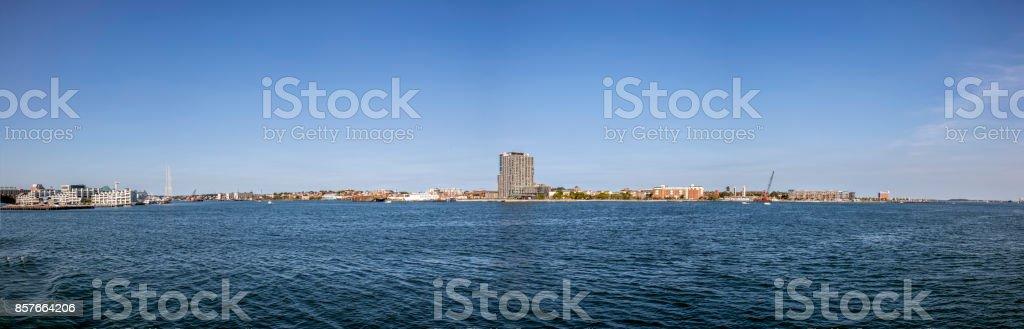 panoramic view to the skyline of Boston, island of Logan stock photo