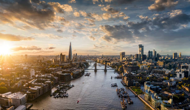 Panoramic view to the skyline of London, United Kingdom, during sunset time Wide panoramic view to the modern skyline of London, United Kingdom, along the Thames river during sunset time london stock pictures, royalty-free photos & images