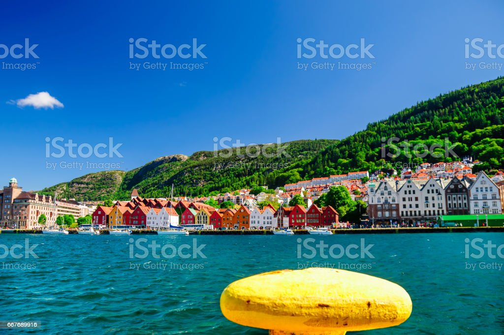 Panoramic view to wooden buidlings of bryggen from pier stock photo