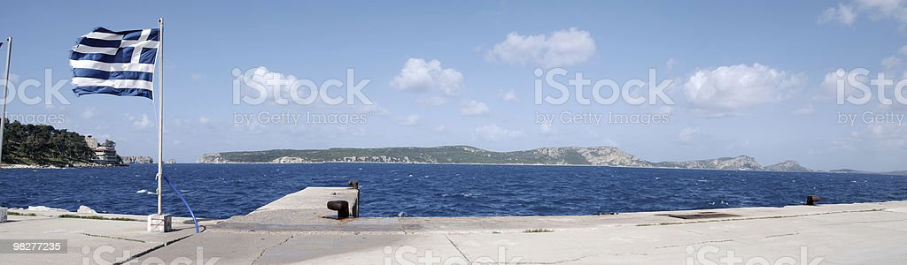 panoramic view with Greek flag and mediterranean sea royalty-free stock photo