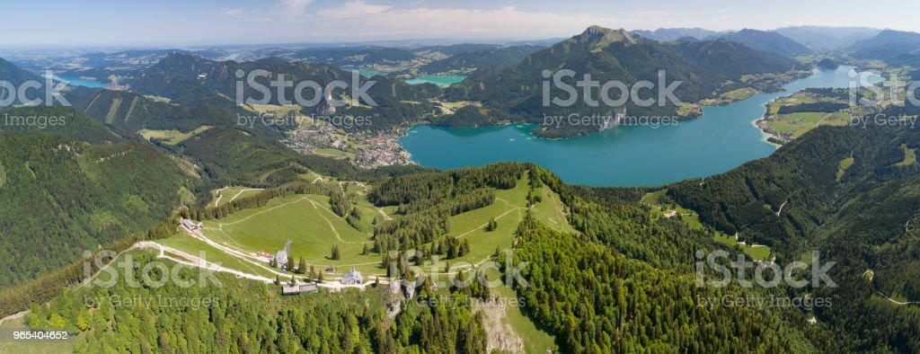 Panoramic View, Zwölferhorn Summit Cross with Wolfgangsee and Mondsee, Austrian Alps, Sankt Gilgen, Austria royalty-free stock photo