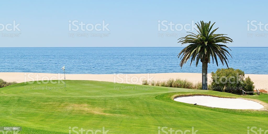 Panoramic views of the golf course to the sea. stock photo