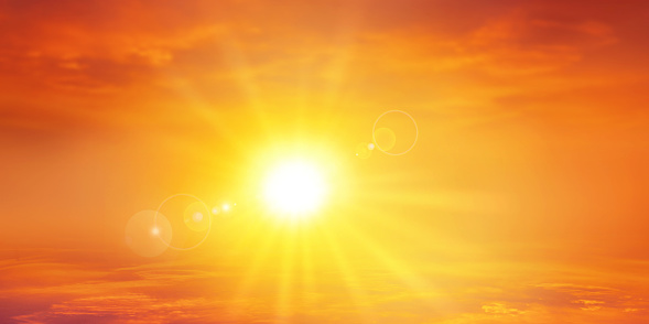 High resolution sky background with a radiant setting sun