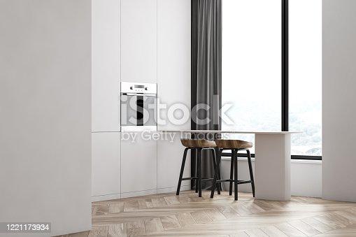 istock Panoramic white kitchen corner with bar 1221173934