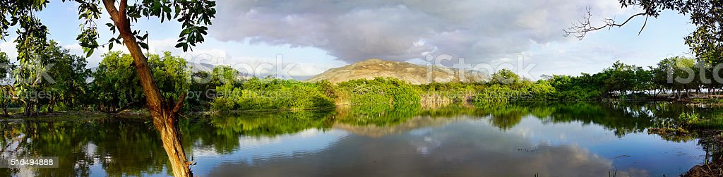 Panoramique landscape, Golden hour sunset on the lake, Montrouis, Haiti stock photo