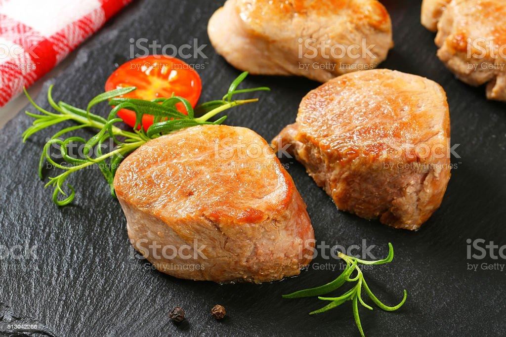 Pan-seared pork medallions stock photo
